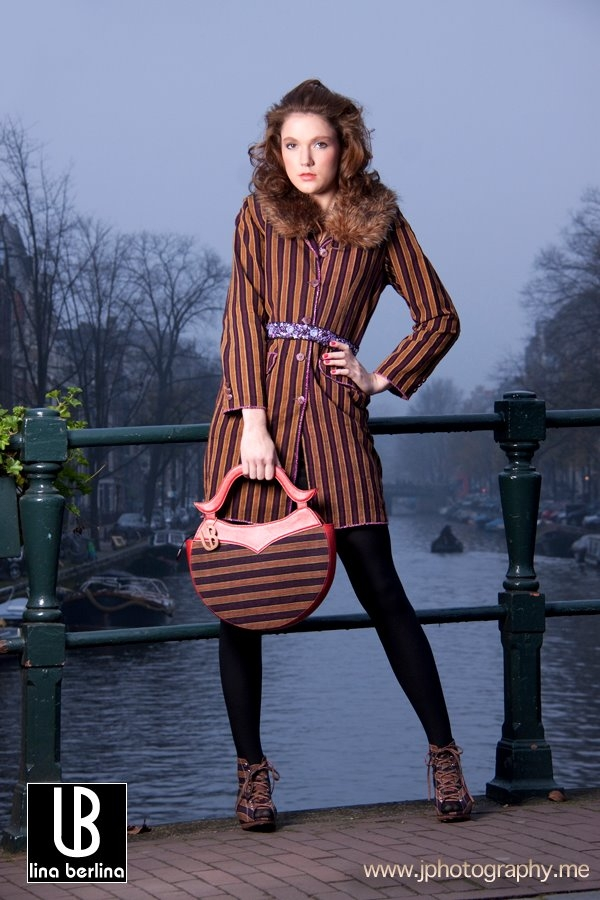 Sam Rinner is wearing a LB Lurik Semi Mantel, and a small Moon bag.
