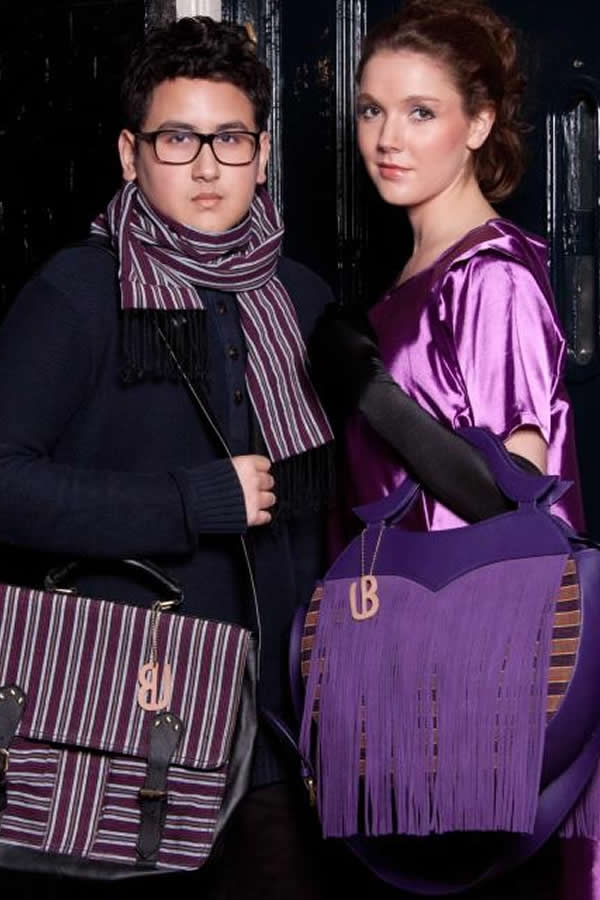Shaka Calern is wearing a Lurik Shawl in purple and a Unisex Bag in Purple. Sam Rinner is wearing Purple Dress and a Tassel Moon Bag in purple.